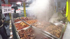 Fresh hot cooked meat for sale at Chinese supermarket. Stock Footage