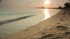 Stock Video Footage of Heart on beach. Romantic composition.