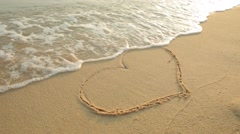 Heart on beach. Romantic composition. Stock Footage