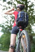 Pretty young female biker outddors on her mountain bike (shallow Stock Photos