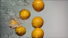 Oranges with splashes of water Stock Footage