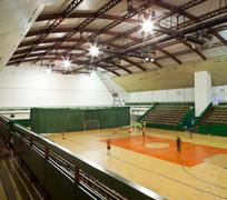 Interior of a modern multifunctional gymnasium with young people Stock Photos