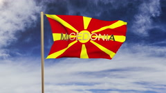 Macedonia flag with title waving in the wind. Looping sun rises style Stock Footage