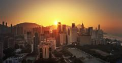 Sunset time with yellow sky in modern city - Hong Kong, China Stock Footage