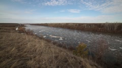 Spring ice drift on the flooded banks river Stock Footage