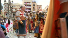 People with red Navarrese emblem on skirts, walk on the parade Stock Footage