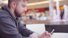 Young Man Typing a Text Message on Your Phone. - stock footage