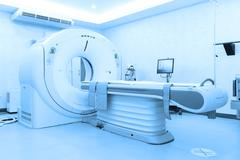 MRI scanner room take with blue filter - stock photo