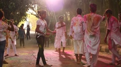 Friends celebrating Holi festival Stock Footage
