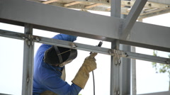 Welder working on the structure of a building. Stock Footage