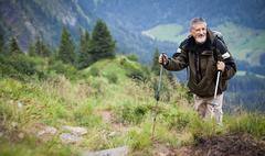 Active senior hiking in high mountains (Swiss Alps) Stock Photos