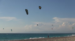 Ionian island beach with kite-surfing contest. Vacation water sports. Holiday. - stock footage