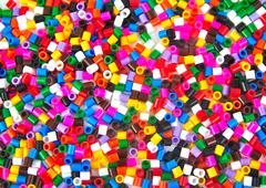Colourful plastic small cylinders toys Stock Photos