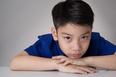 Portrait of asian cute boy sad and  looking very disappointed Stock Photos
