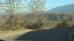 Driving shot inside a car moving on a mountain road in a holiday trip. POV. - stock footage