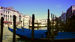 Rialto Bridge on Grand Canal of Venice Italy- vaporetto passing by Stock Footage