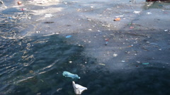Sea pollution and jelly fishes on surface of wavy sea water Stock Footage
