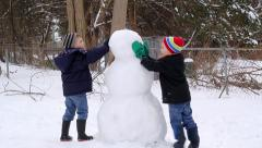 Children Making a Snowman Stock Footage