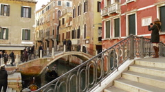 Tourists on bridges of Venice Italy Stock Footage