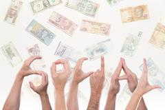 Word social with different currencies Stock Photos
