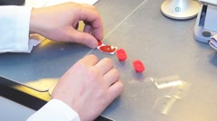Specialist optician prepares lenses for glasses customer, medicine eye. - stock footage