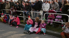 Kids whistling at Spring Carnaval on the France streets Stock Footage