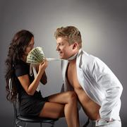 Sexy girl attracts dancer with pack of dollars - stock photo