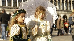 Carnival dressed girls posing for crowds in Venice Italy Stock Footage