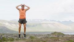Burpee man doing burpees exercise fitness workout in amazing nature on Iceland Stock Footage