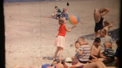 Girl plays with a ball on the beach. Vintage film 1966 Stock Footage