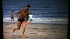 Boy running along the seashore. Vintage. - stock footage