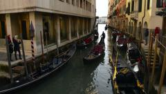Gondolas sailing down the canals of Venice Italy Stock Footage