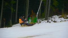 Man climbs up on a sled, sledding, Stock Footage