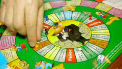 Cashflow game, Adults play a board game Stock Footage