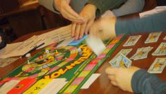 Cashflow game, Adults play a board game - stock footage