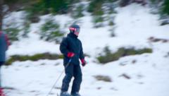 Skier descends from the mountain,ski resort,skiers,extreme speed Stock Footage