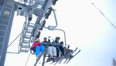 Ski lift raises the mountain people Stock Footage