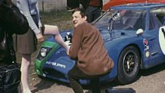 Le Mans 1972: model posing before the race Stock Footage
