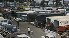 Le Mans 1972: trucks parked outside the racetrack Stock Footage