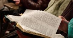 Flipping Through Bible At Church 4k - stock footage