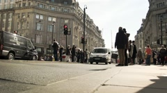 Oxford Circus, London: shoppers crossing the road Stock Footage