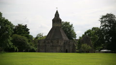 A small church on the green grass in the Glastonbury abby Stock Footage