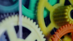 Colorful Plastic Gears Rotate Synchronously Stock Footage