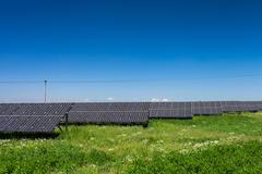 Sunlight as a resource of renewable energy: solar panels on a su Stock Photos