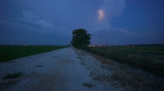 Lightning Storm During Blue Hour Over Single Tree Stock Footage