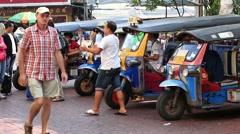 Stock Video Footage of Thai tuk-tuk vehicles waiting for passengers on Khao San Road. Bangkok, Thailand