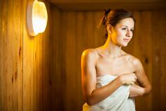 Young woman relaxing in a sauna - stock photo