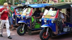 Stock Video Footage of Thai tuk-tuk vehicles waiting for passengers on Khao San Road in Bangkok