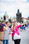 Stock Photo of Two female tourists walking along the Charles Bridge while sight