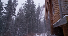 Snow Falling off House in the Woods Roof Slowmo 4K Stock Footage